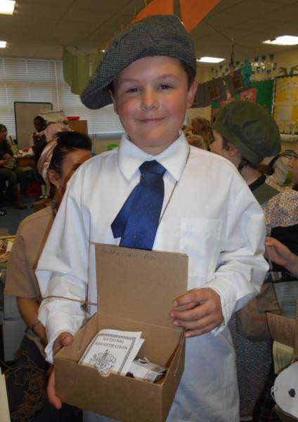 Freddie Evans of Acer Class taking part in the Second World War living history experience at Pot Kiln Primary School.