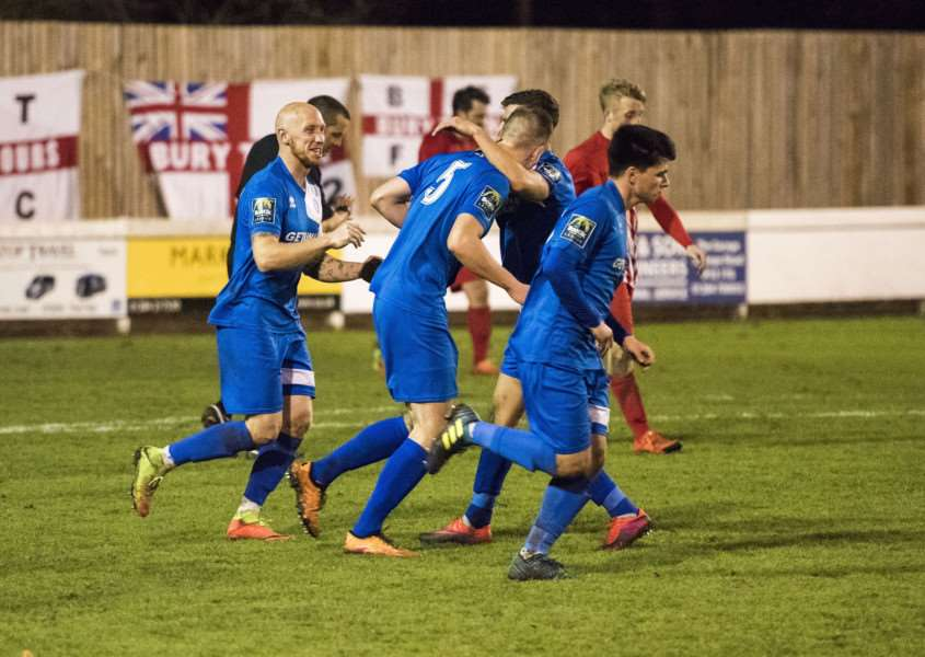 SUBDUED CELEBRATIONS: The players celebrate Joe White's 87 minute equaliser