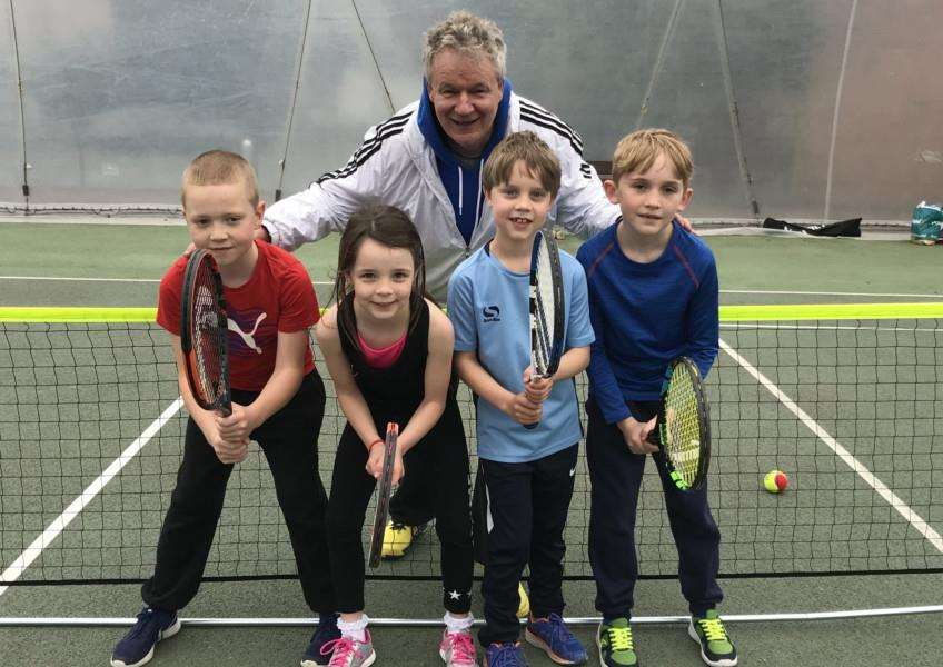 RISING STARS: Coach Bruce Tarran with the victorious Under-8 Mixed team