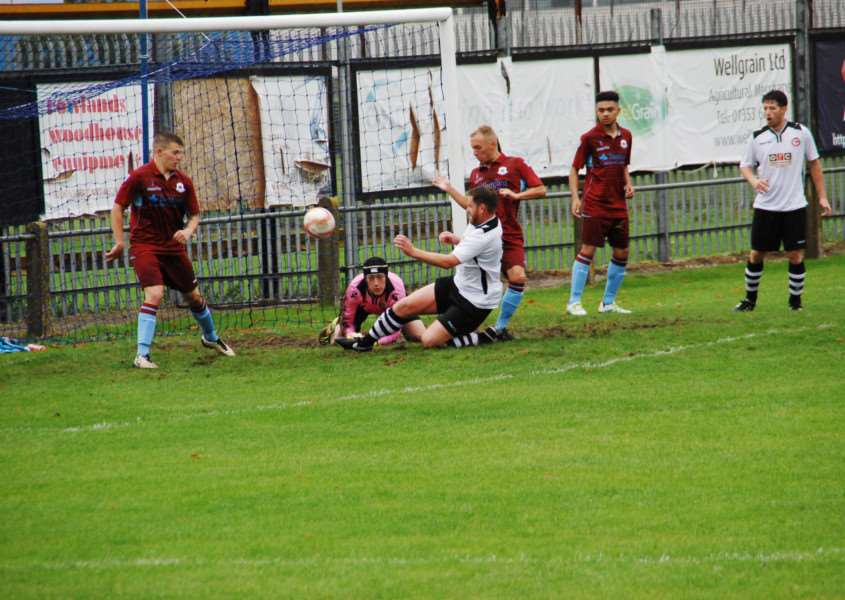 Sam Holmes pounces on a loose ball to score his first goal of the season and put Haverhill Rovers on their way to a 2-1 win at Thetford Town. Picture courtesy of Haverhill Rovers. ANL-160310-142118002