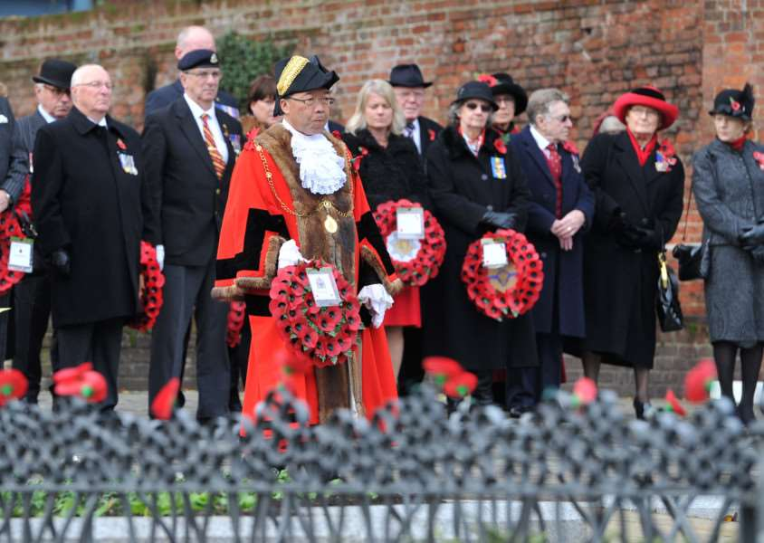 Mayor of St Edmundsbury Patrick Chung steps forward to lay a wreath on behalf of the borough ANL-150811-231147009