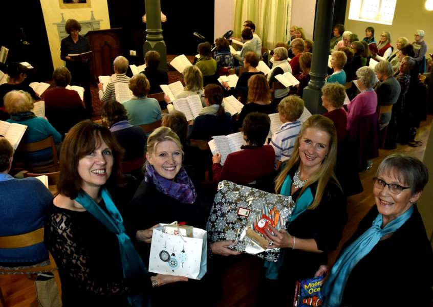 Pictured in front are Aquarius Singers members handing over a few of the gifts collected by them for families who will turn to Bury Women's Aid. From left: Becky Worth, Annie Munson, chief executive of Bury Women's Aid, Sonia Jewers and Janet Todd. Picture: Andy Abbott ANL-161124-135924001