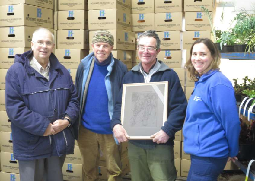 Andrew Daniels with the picture presented to him for 25 years service at Howard Nurseries. Pictured are, from left, David Howard, Timothy Easton, Andrew Daniels and Christine Howard