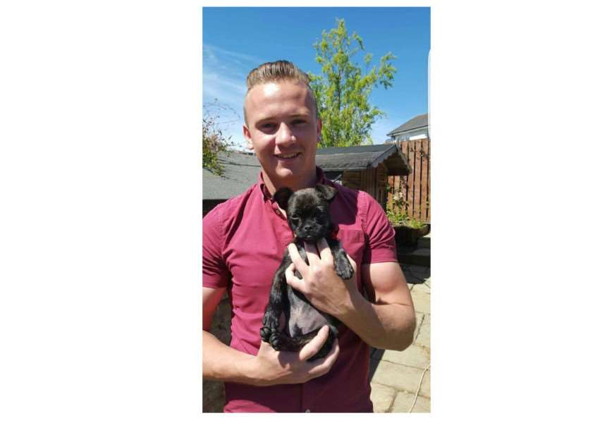 Corrie McKeague with his pug-cross puppy Louell who was left in his room at RAF Honington when he went missing ANL-160710-181117001
