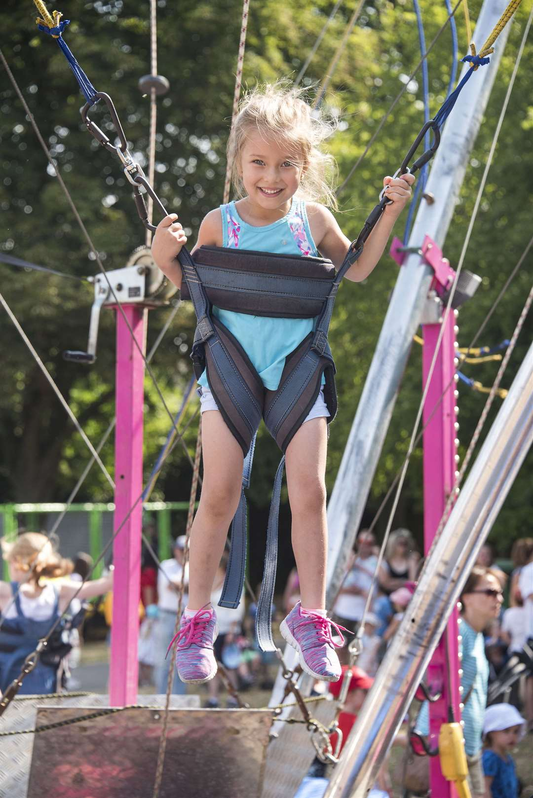 Five-year-old Indie Thompson enjoying a bungee trampoline at last year's Big Day Out. Picture by Mark Westley