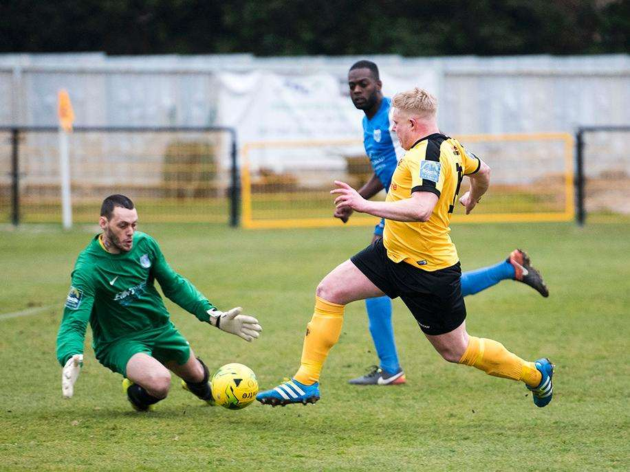 NO LUCK: Mildenhall Town's Steve Holder rounds the Barking goalkeeper but was unable to tuck his shot away as the Hall fell to a 2-0 home defeat Picture: Mark Westley