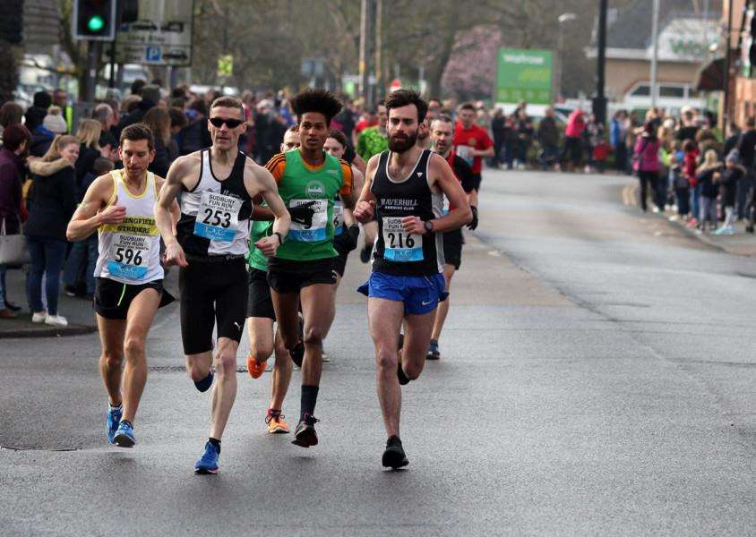 LEADING PACK: Haverhill Running Club's Michael Gilbert (far right) went on to be the eventual overall winner of the Sudbury Fun Run. Picture: Andy Howes