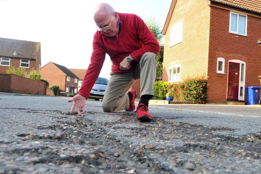 Cllr Frank Warby is complaining about the state of the roads on Moreton Hall, in particular Raedwald Drive ANL-151210-182602009