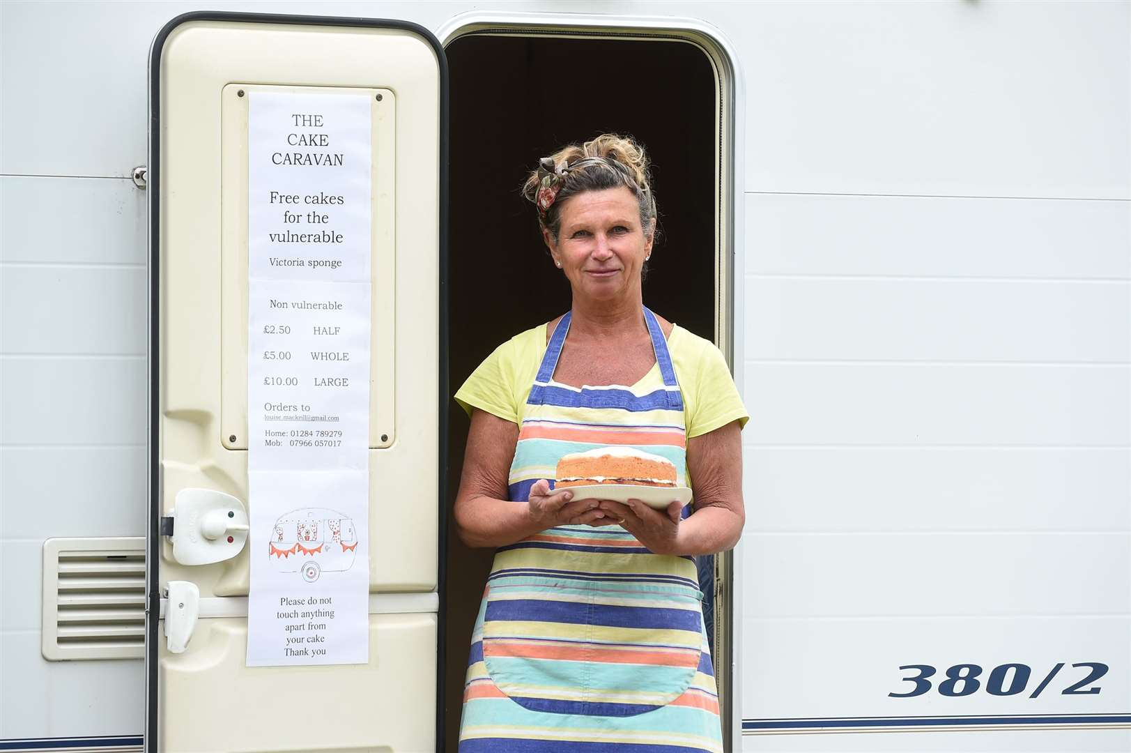 Louise Mackrill in the doorway of her Cake Caravan. Picture by Mecha Morton ....