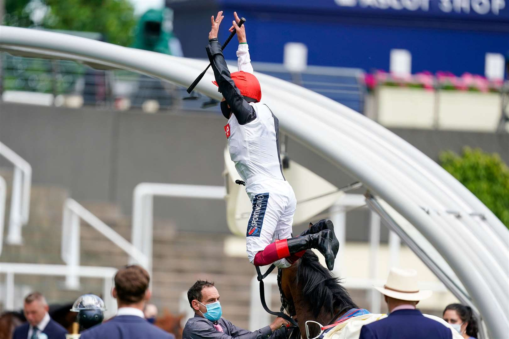 ASCOT, ENGLAND - JUNE 16: Frankie Dettori leaps from Frankly Darling after winning The Ribblesdale Stakes at Ascot Racecourse on Day 1 of the Royal Meeting on June 16, 2020 in Ascot, England. The Queen will miss out on attending Royal Ascot in person for the first time in her 68 year reign. Her Majesty is reported to be planning to watch the racing from home at Windsor Castle, but she will not be able to attend, as the meet goes on behind closed doors due to the Covid-19 pandemic. (Photo by Alan Crowhurst/Getty Images). (36980766)