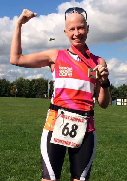 Liz pictured after she finished the sprint tri, in September 2015, after her third cycle of chemo ANL-160824-130257001