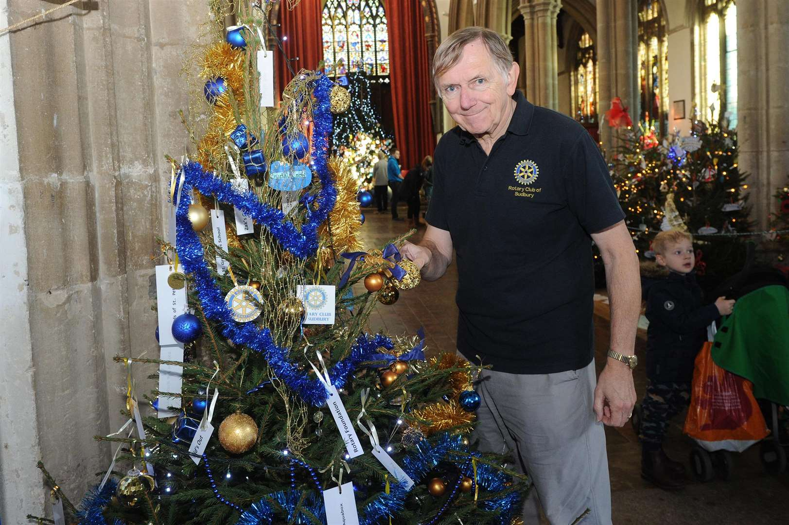 A Christmas tree festival has been staged at St Peter's, organised by Sudbury Rotary Club...Pictured: David Taylor of Sudbury Rotary Club with their Christmas tree...PICTURE: Mecha Morton. (5877117)