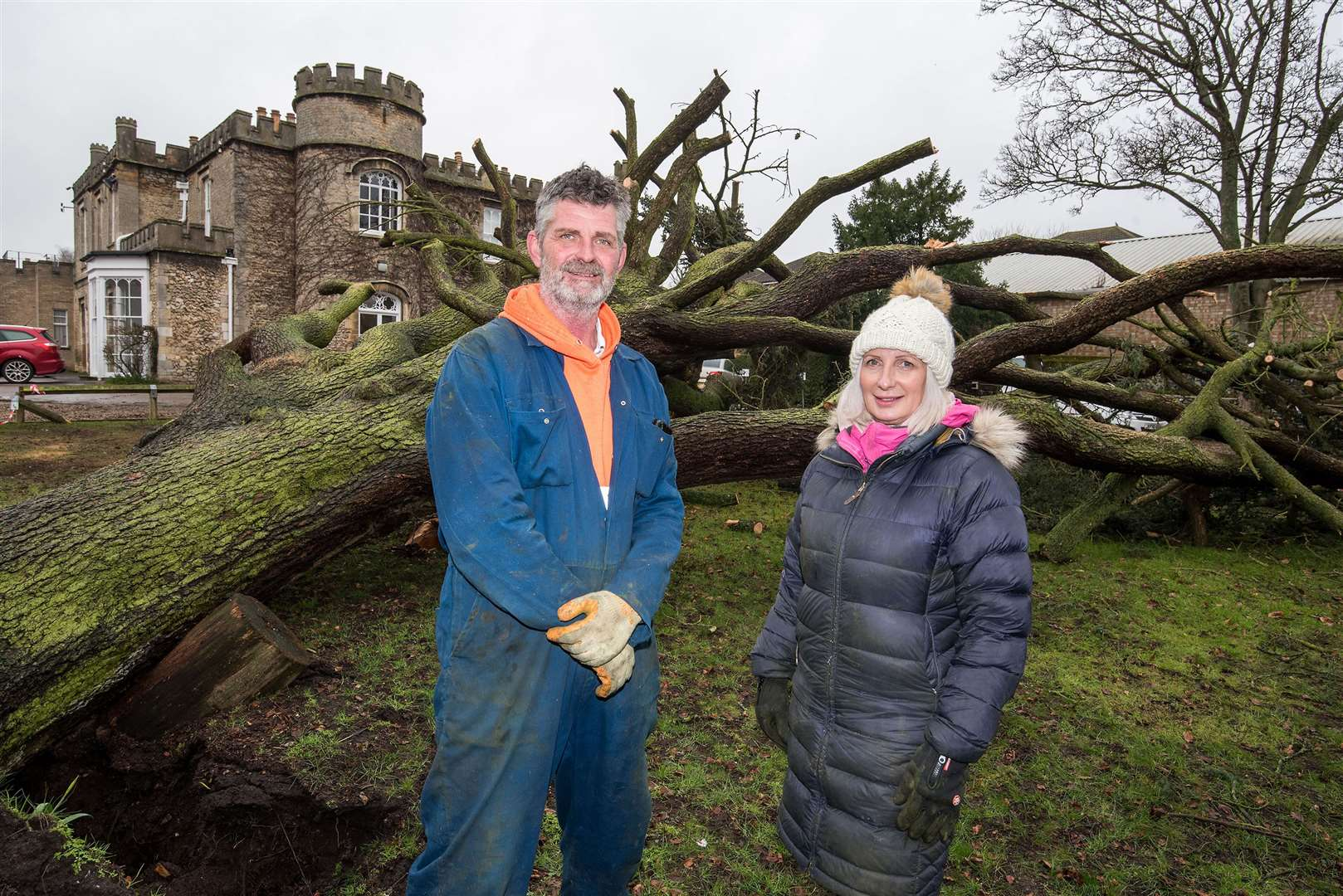 Karyn Scott, managing director with her husband Kevin, with the fallen tree. Picture: Mark Westley