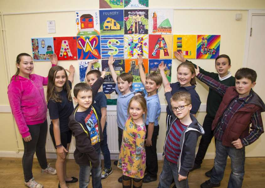 Members of Lawshall Youth Club with their art work