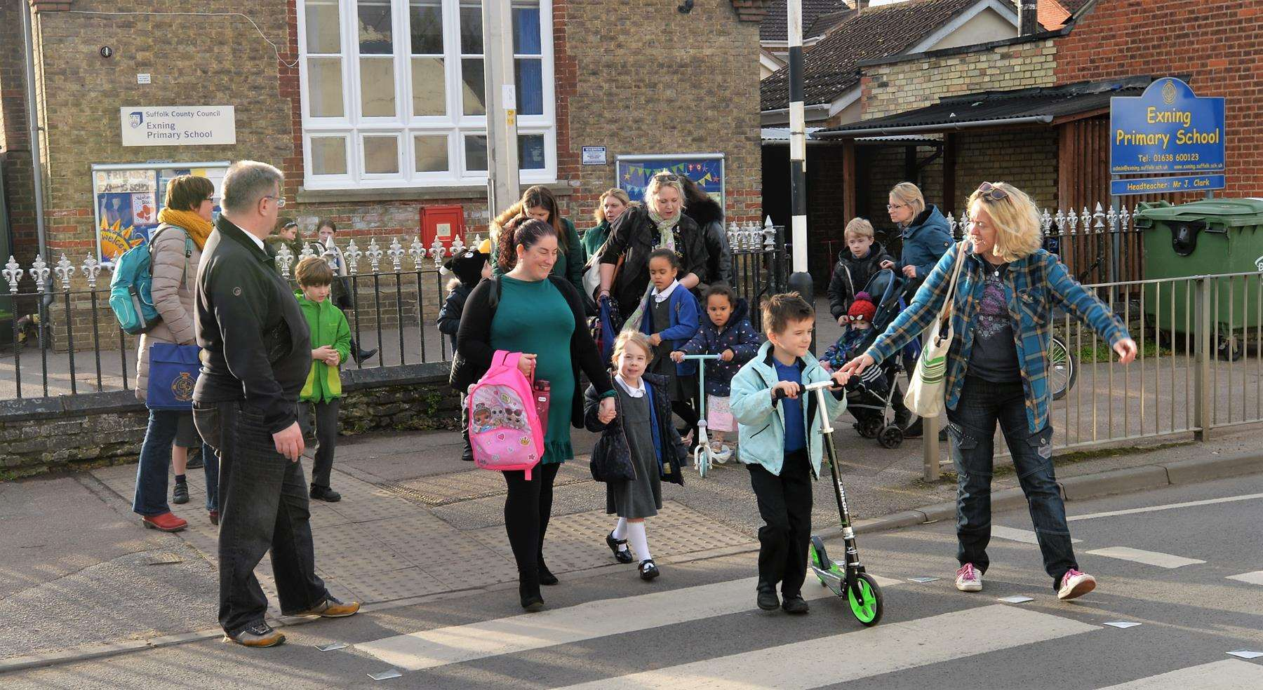 Cllr Simon Cole with parents and children crossing outside Exning Primary School, in Oxford Street