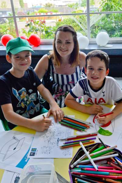 Tina Matthews with sons Oli, age 10, and Benjamin, age six, enjying the Great Get Together event at the Charles Burrell Centre in Thetford