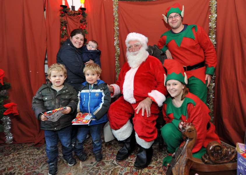 Lavenham Christmas Fair''Pictured: Oliver and Harry Clark (Both 3), Laura Addison with Jack Addison (9 months), Santa and the Elfs
