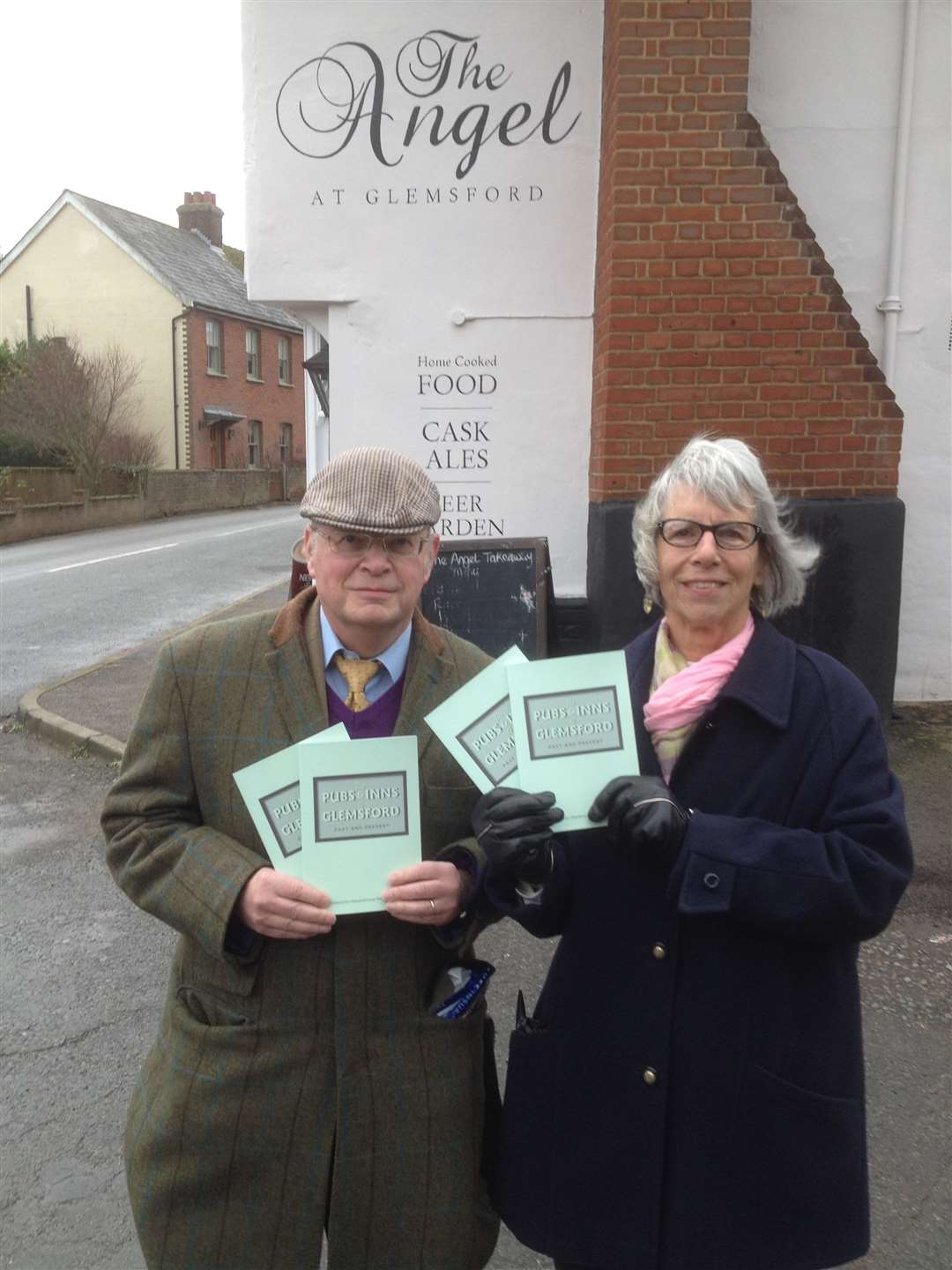 Jenny Wears with Patrick Hemphill from Glemsford Local History Society who have published a book on the pubs in the village (6111289)