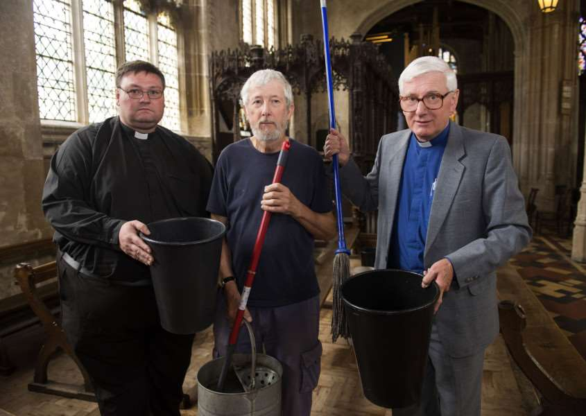 Reverend Mark Woodrow, curate of Lavenham church, with church cleaner Richard De'ath and church rector Rev Stephen Earl