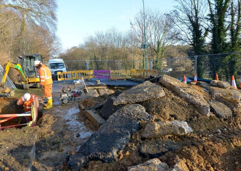 Engineers from Anglian Water are working to repair a sink hole in Newton Road, Sudbury