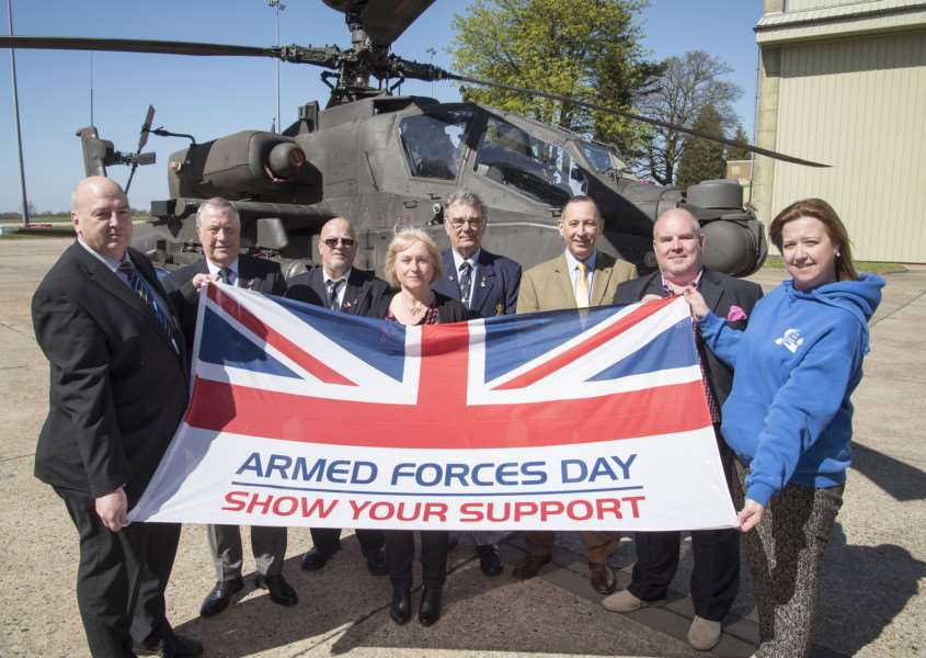 Armed Forces Day 2016 event organising committee and councillors and an Apache attack helicopter.'Picture Mark Westley ANL-160420-191916009