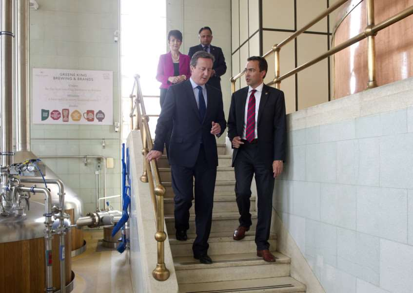 PM David Cameron visiting Greene King. Shown around by Head of breweries operations David Carr ANL-160614-171953009