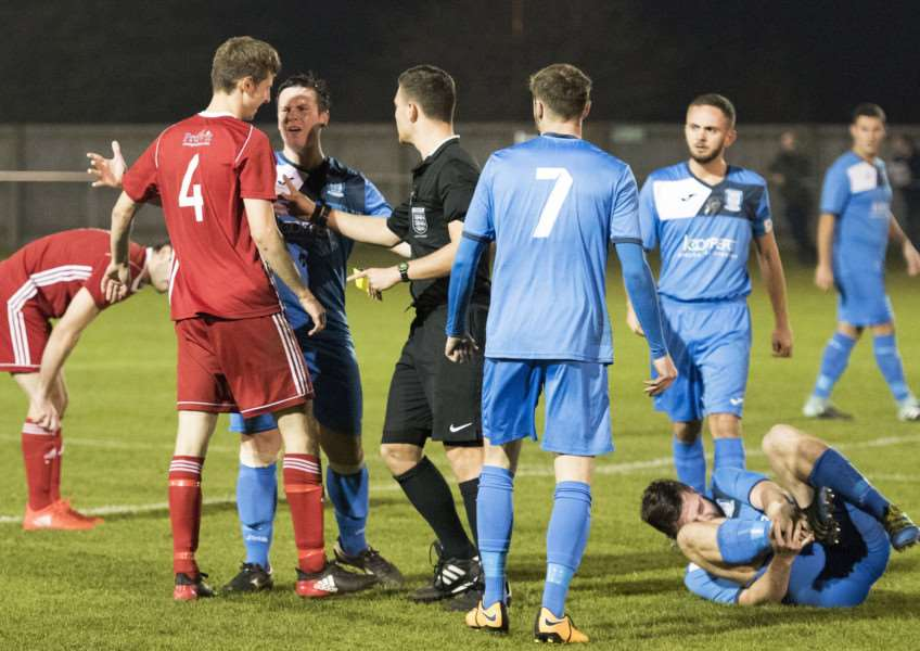 INTENSE EXCHANGE: There were a few incendiary moments in the game, and five bookings
