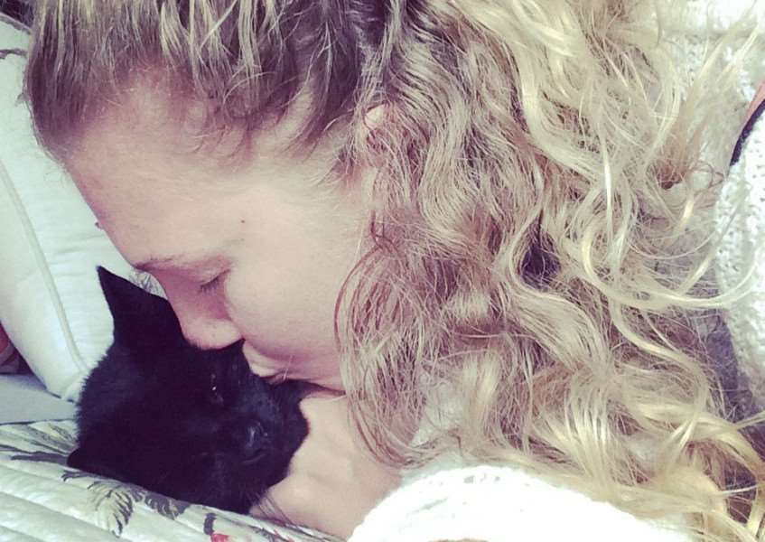Brianna Dale with her cat Napoleon who was killed by a dog that strayed into a neighbour's garden