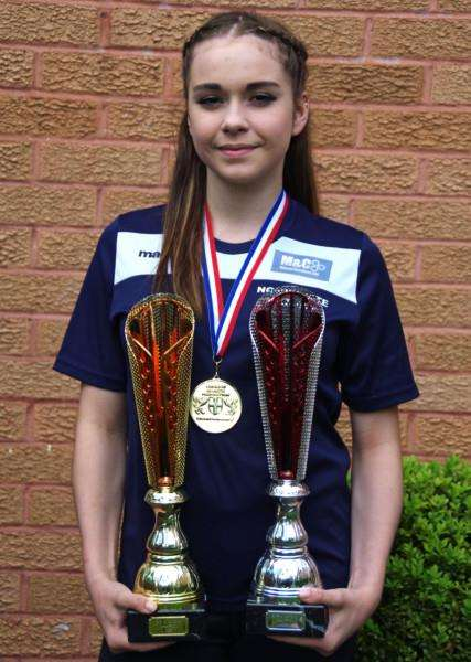 GOLDEN GIRL: Georgina Lawson, 15, shows off her trophies and medals from Glasgow and Sheffield