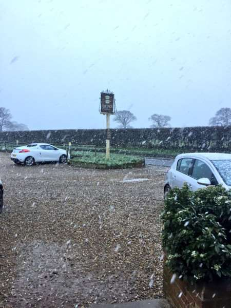 Snow coming down at The Pigs Pub in Edgefield in Norfolk this morning