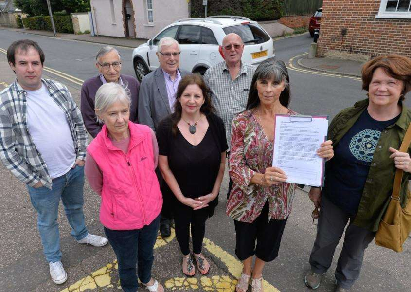 Anne-Marie Hughes, centre right, with Fitzroy Street residents who have started a petition for traffic calming measures