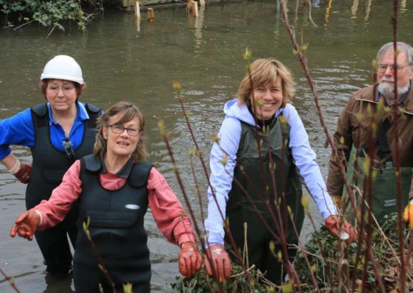 Volunteers working in the River Lark in Bury's Abbey Gardens in March