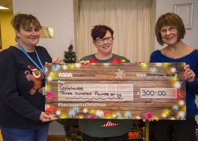 Gatehouse Bury St Edmunds.'Christmas hamper appeal.'Michelle Frost presents a cheque to Trustee Julia Wakelam and CEO Amanda Bloomfield for the appeal'Picture Mark Westley ANL-151215-130252009