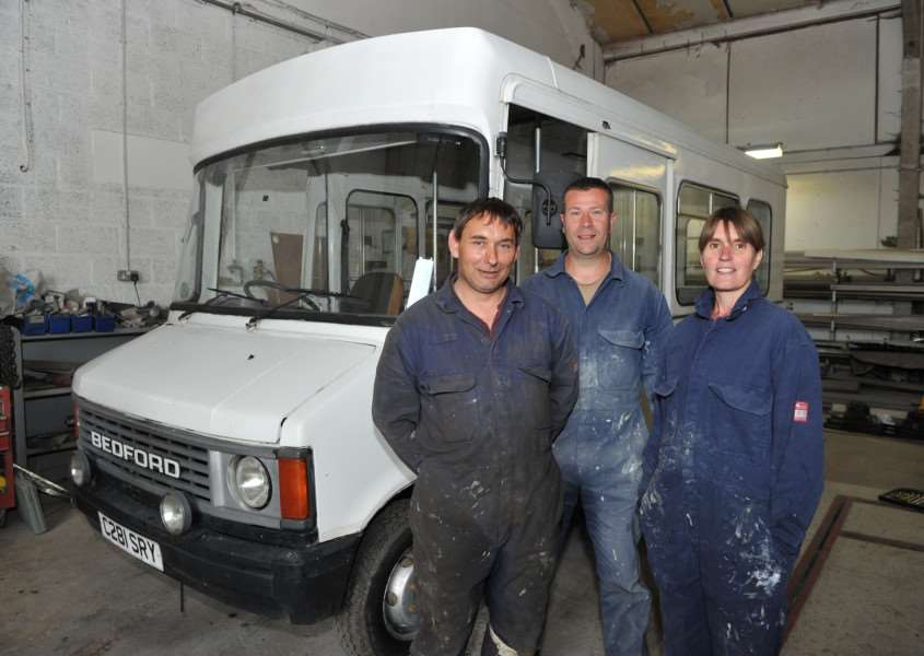 Vehicle repair company James Sewell and Son have helped do up a VW Beetle for Channel 4 TV show For the Love of Cars''Pictured: Edward Debenham, James and Tina Newell ANL-150806-153900009