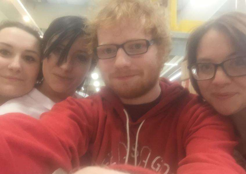 Tammy Thorpe, Kayleigh Richards and Abigail Goodswen get a snap with Sheeran. ANL-150724-142450001