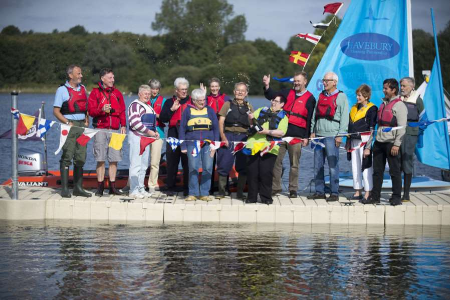 LACKFORD LAKES: Unveiling of the new jetty from Asda Foundation Grant, Michelle Frost community life champion cuts the ribbon, with Mike Steele, Cllr Susan Glossop and Alan Turvey'Picture Mark Westley ANL-150929-174303009