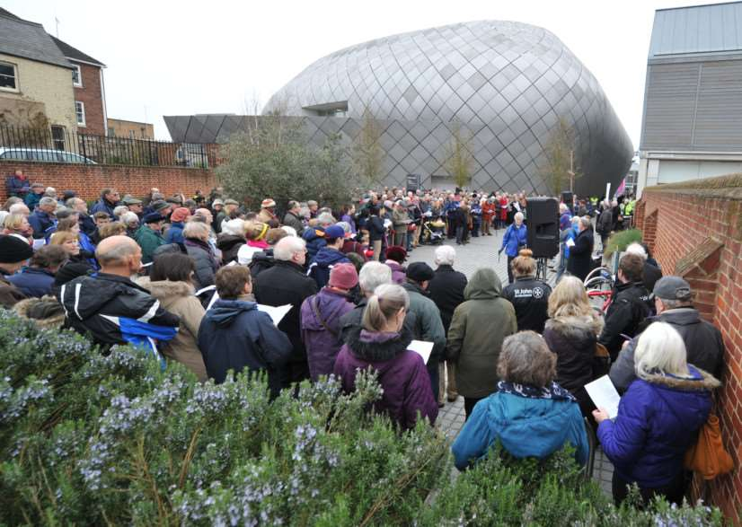 Walkers pack Hanchett Square for a service ANL-150604-220543009