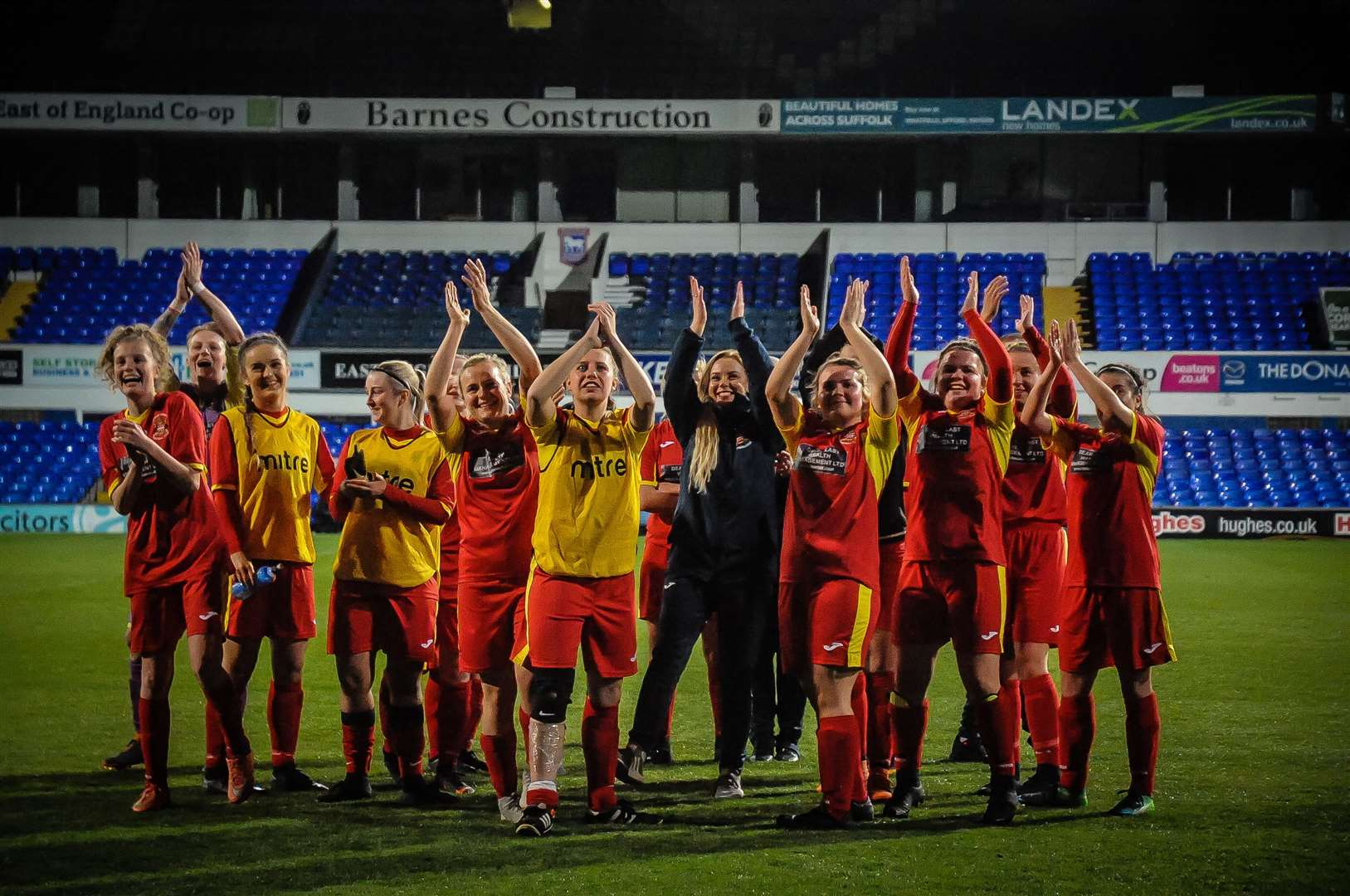 Needham women salute their noisy fans at Portman Road after a clinical display of finishing saw them lose the Suffolk Women's Cup final 8-0 Pictures: Ben Pooley