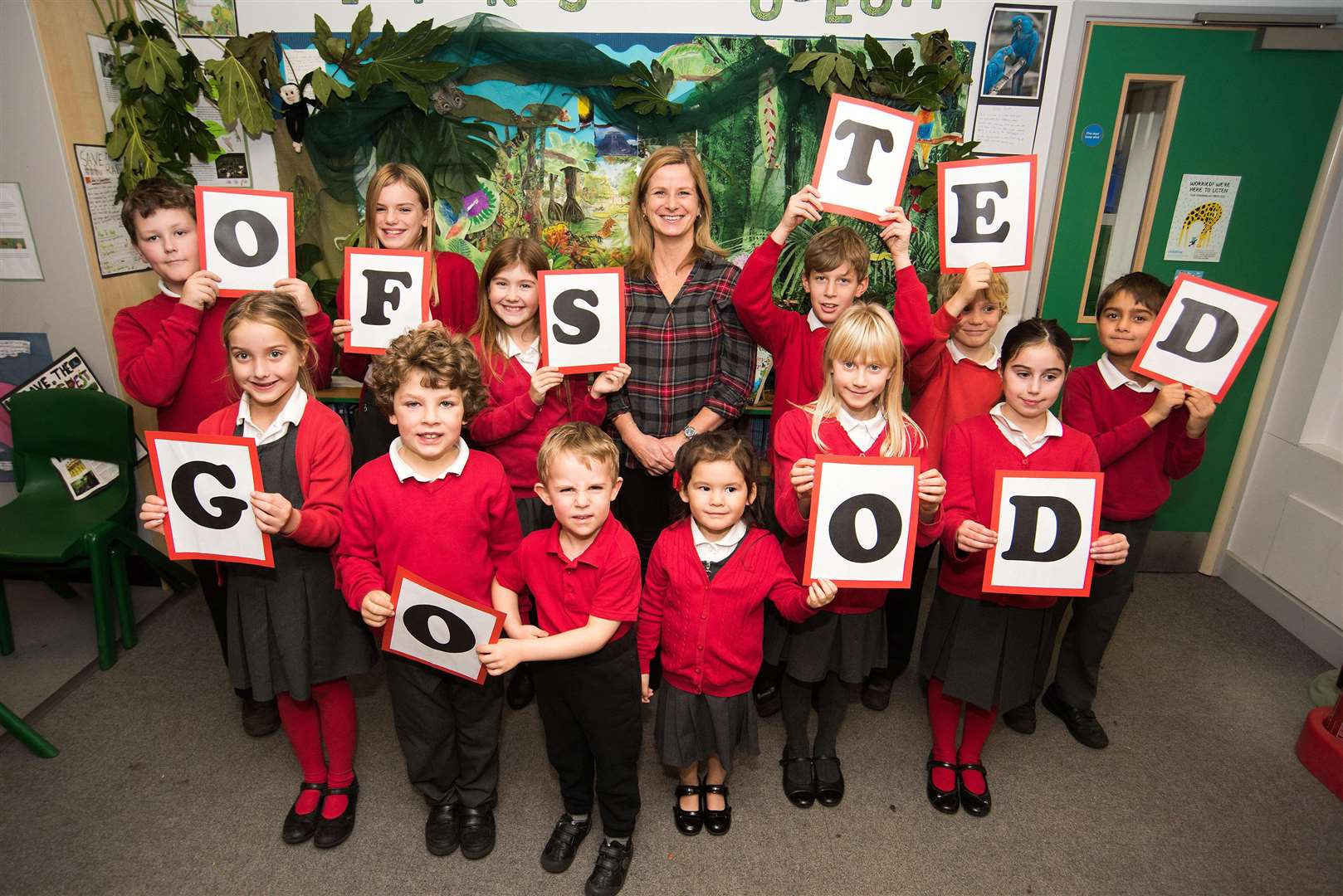 Rattlesden Primary School has been awarded 'good' Ofsted rating. Helen Ballam (headteacher) with pupils. Picture: Mark Westley.