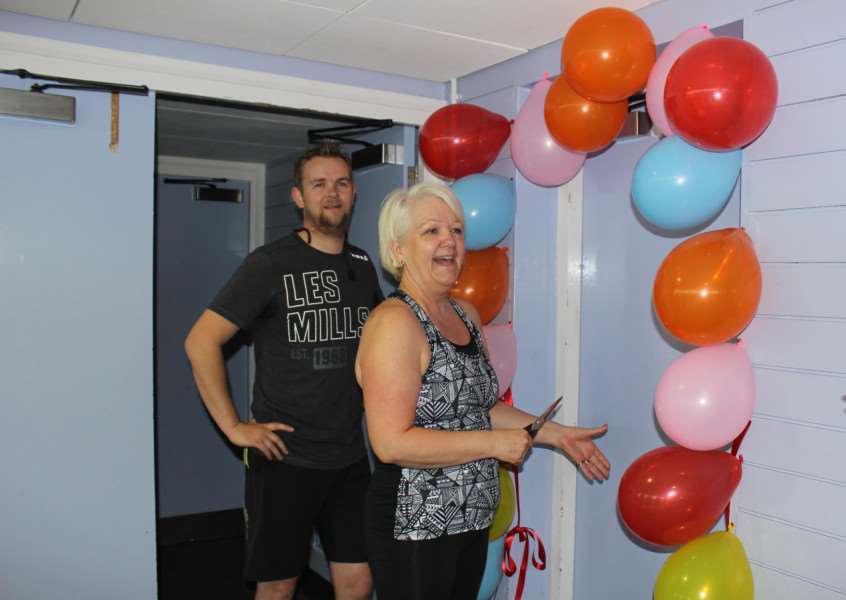 Former staff member and exercise class regular Lynn Licence opens the new studio space at Bury St Edmunds Leisure Centre watched by instructor Martin Hewitson. ANL-150515-135258001