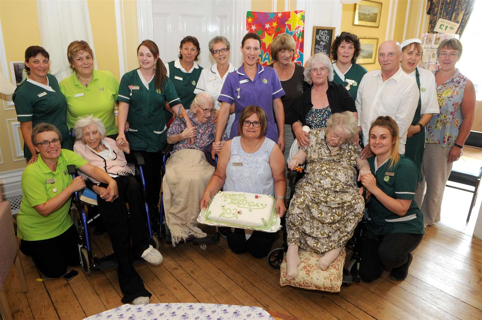 Stowlangtoft Nursing home are celebrating three residents turning 102..Pictured: Family, Staff with Kathleen Fraser-Harrison, Jean Curr and Marguerite Seal...PICTURE: Mecha Morton. .. (3136868)