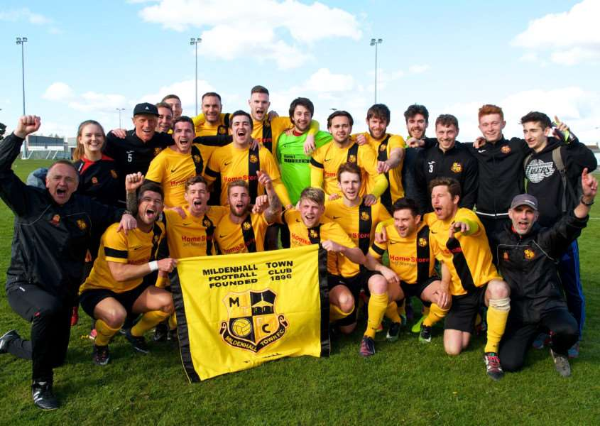 CHAMPIONS: Simpson (bottom row, second left) celebrates Mildenhall's title-winning success with his team-mates and the management