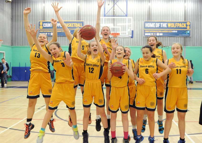 JUMPING FOR JOY: The County Upper team celebrate