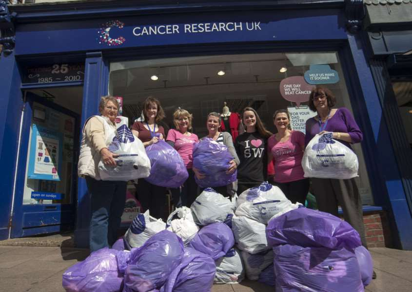 Mark Westley Photography'Local Slimming World groups have been donating clothing which they've slimmed out of to the Cancer Research UK shop, in Abbeygate Street.'Maureen Thurlbourn, Kelly Cooper, Tina Matthews, Sarah Monteiro, Sarah Kesterton Shop manager with volunteers Maggie Jenkinson and Valerie Baldwin. ANL-150519-213752009