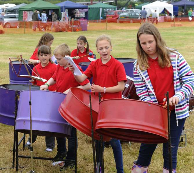 Hockwold Country Fair'Year 5 & 6 pupils from The Iceni Academy Primary School Hockwold, entertain in the main arena with the steel pans. ANL-150614-174340009