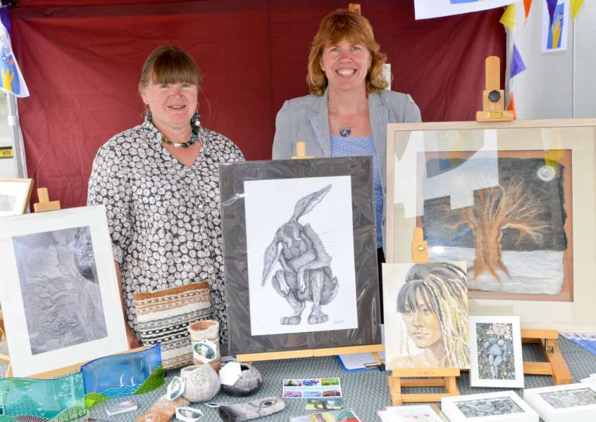 Suffolk Art Trail Stall held at Sudbury Market. Artists Catherine Allen and Rebecca Mainsbridge at the stall. ANL-160529-133101009