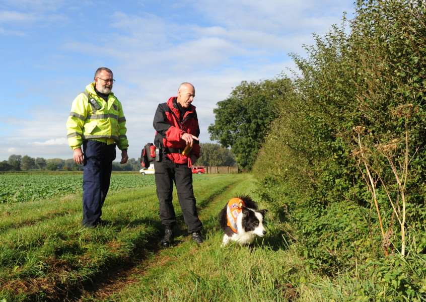 Search for Corrie McKeague continues at Ingham''Pictured: search manager Kevin Waterson, left, and, dog handler Dave Forster with Jack the air scent search dog ANL-161110-151536009
