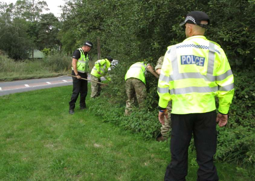 Police, RAF and Military Police personnel search hedgerows beside the A134 between Bury and RAF Honington for Corrie McKeague ANL-160930-161420001