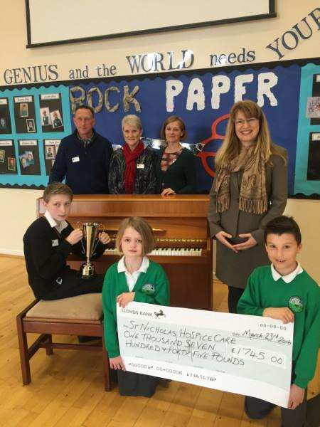 Abbots Green pupils present donation to St Nicholas Hospice Care