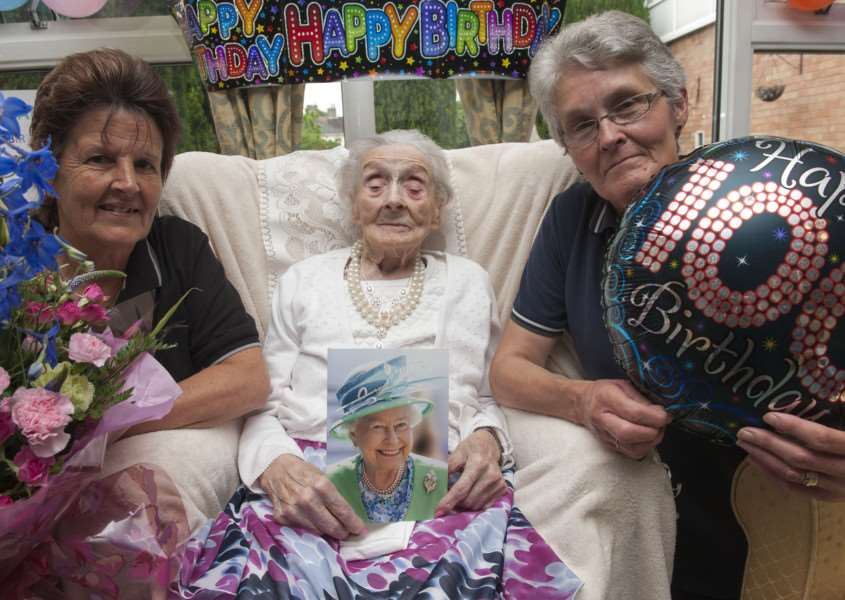 Muriel Daisy Bloomfield celebrates her 100th birthday, in Hazell Court Sudbury pictured with carers Kay Goodson and Pauline Murcott. ANL-150625-000346009